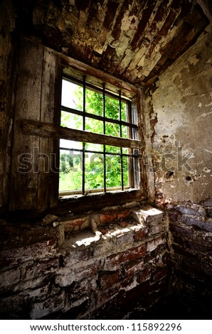 window in an old broken shed - stock photo