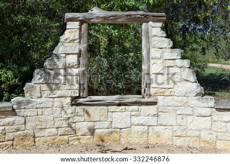 window in an old stone wall - stock photo