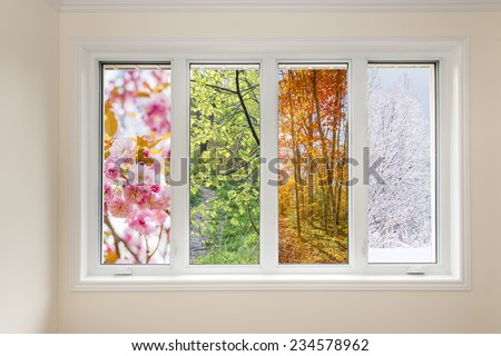 Window in home interior with view of four seasons - stock photo