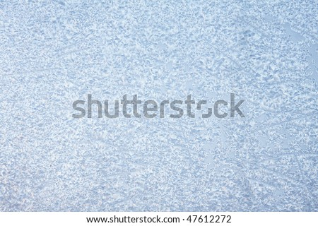 Window in ice in the winter - stock photo