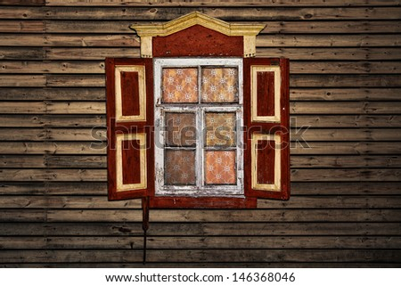 Window in old wooden house - stock photo
