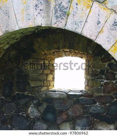 Window in stone wall of Suomenlinna Sveaborg Fortress in Helsinki, Finland - stock photo