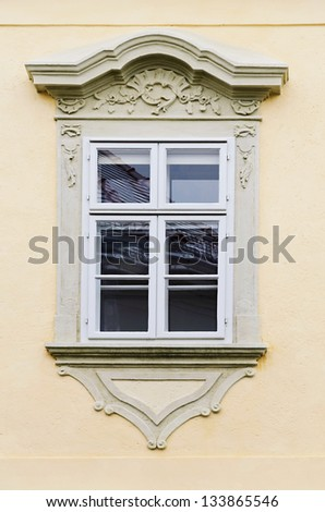 Window In The Yellow Wall Of The House - stock photo