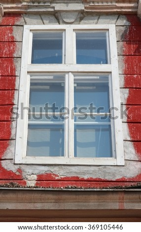 Window in Timisoara - city in Banat region of Romania. Timis county. Old residential architecture detail.