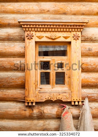 Window in wooden log house in Russian village in the middle Russia - stock photo