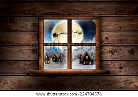 Window in wooden room against santa delivery presents to village - stock photo