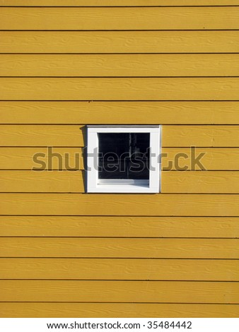 Window in yellow house - stock photo