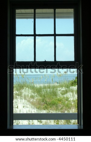 window looking out onto beach - stock photo