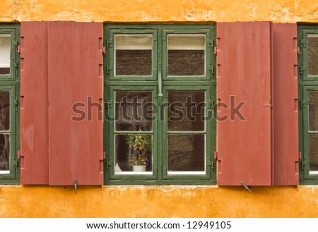 Window of a colorful rustic cottage - stock photo