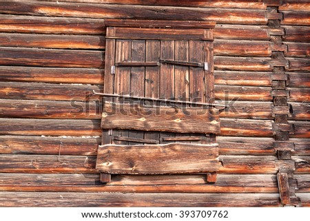 Window of a old wooden cottage as a texture or background - stock photo