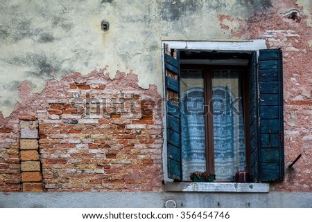Window Of An Old House With Decaying Brickwork - stock photo