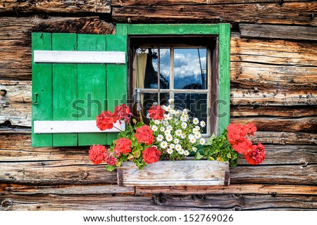Window of an old wooden cabin - stock photo