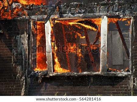 window of house on fire