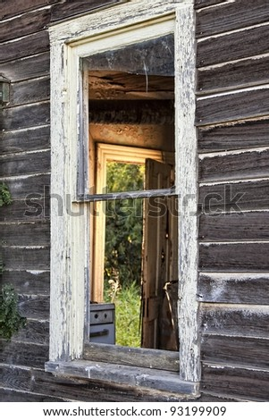 Window of old, wooden home in the countryside - stock photo