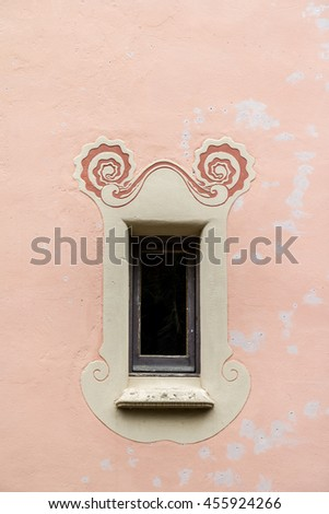 window on a red plaster wall
