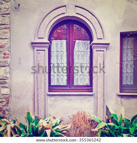 Window on the Facade of Italian House Decorated with  Flower, Instagram Effect - stock photo