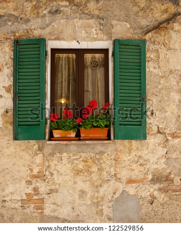 Window on the Facade of the Old Italian Home - stock photo