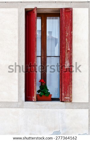 Window on the Facade of the Restored Italian Home - stock photo