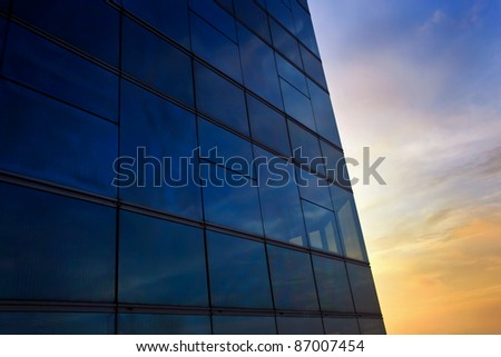 window reflection at sunset time as blue background - stock photo
