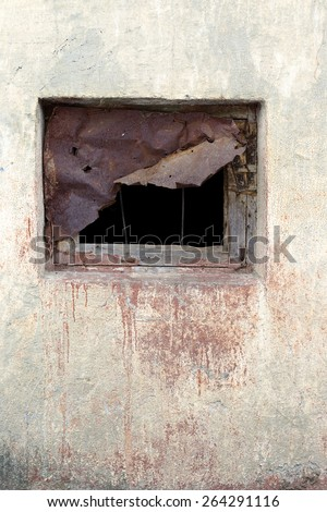 Window scored piece of rusty iron plate on the wall with scratches and cracks. Great background or texture for your project. - stock photo