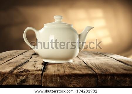 window shadow and teapot  - stock photo