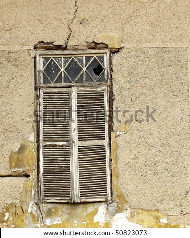 Window shutters of an old abandoned house - stock photo