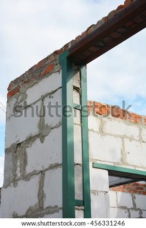 Window steel lintel on brick house construction. - stock photo