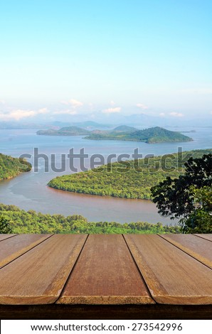 Window View of Andaman Sea from Western Coast of Thailand with Wooden Table.