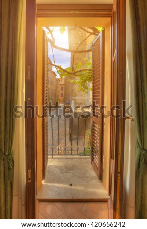 Window view on old street, Tuscany, Italy - stock photo
