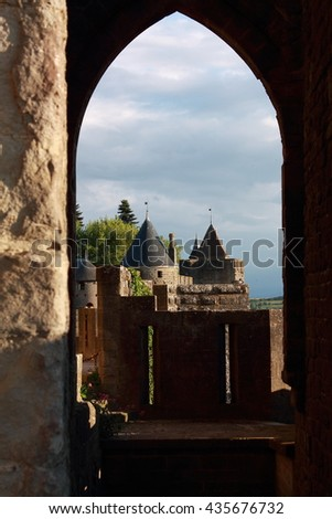 window view on towers of castle of carcassone, south france - stock photo