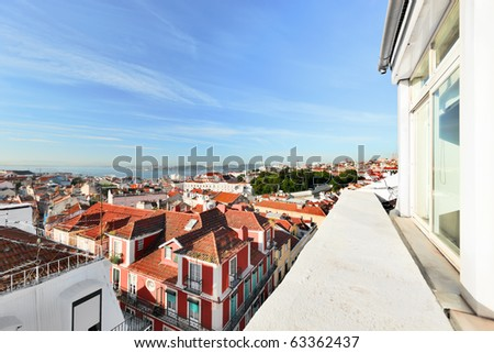 Window view to roofs of Lisbon. - stock photo