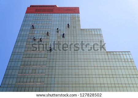 window washers on a highrise office building