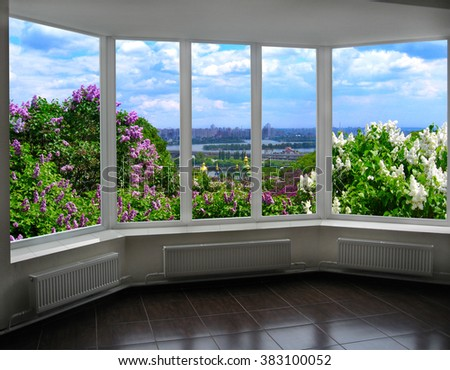 window with beautiful view of Kyiv in spring with bushes of lilac
