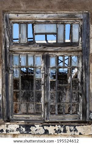 window with broken glass - stock photo