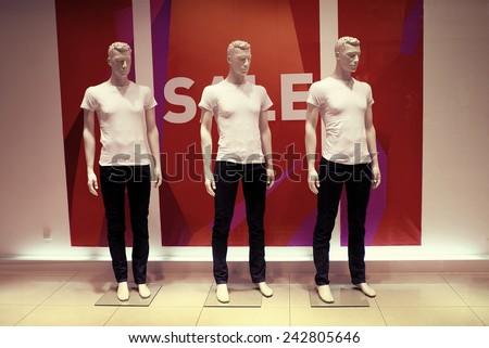 window with dressed man mannequins - stock photo