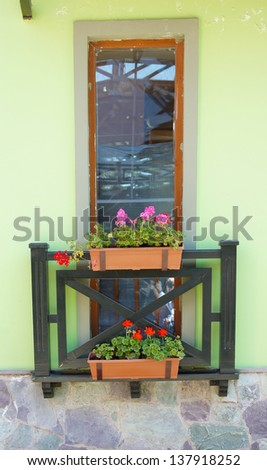 Window with flower pot and bright flowers