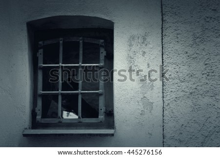 window with lattice on a stone wall background. Toned