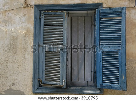 Window with old blue shutters