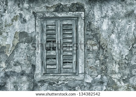 Window with shutter in old abandoned house - Croatia.