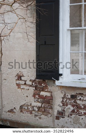 Window with shutters, and peeling plaster - stock photo