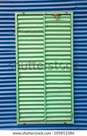 Window with shutters in La Boca - stock photo