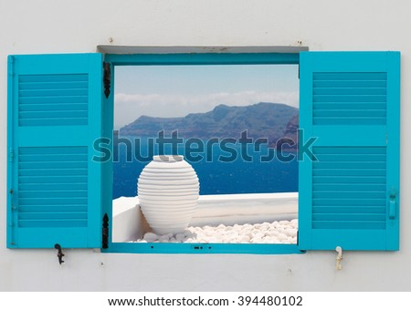 window with view of  white greek amfora against volcano caldera,  Santorini island, Greece - stock photo