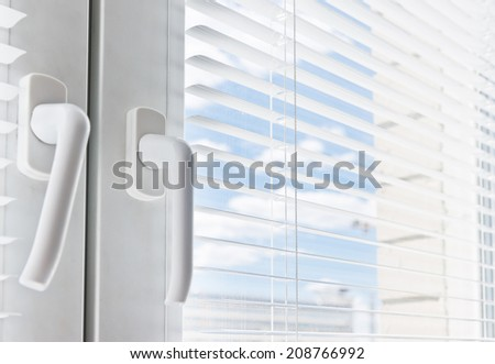 Window with white jalousie, close up  - stock photo
