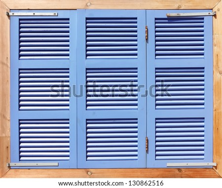 Window with wooden blue shutters - stock photo