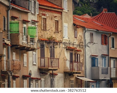 Windows and balconies at the Baska street