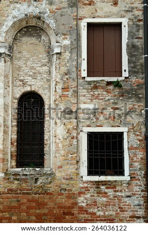 Windows and door on a small venetian channel, Venice, Italy