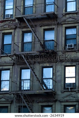 Windows and escape ladders on a New York apartment building.