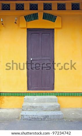 Windows, doors, walls yellow. - stock photo