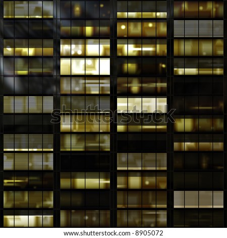 Windows in a high rise tower block or skyscraper at night - stock photo