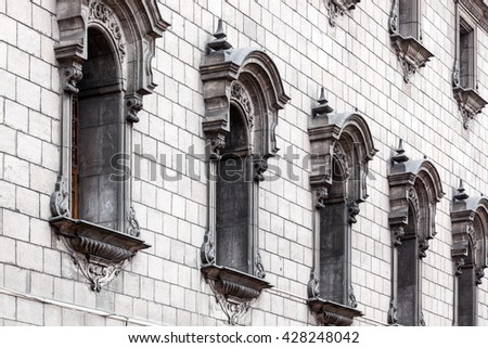 windows in a row on a beautiful building - stock photo